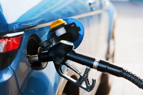 Gas pump inside of car putting gas inside