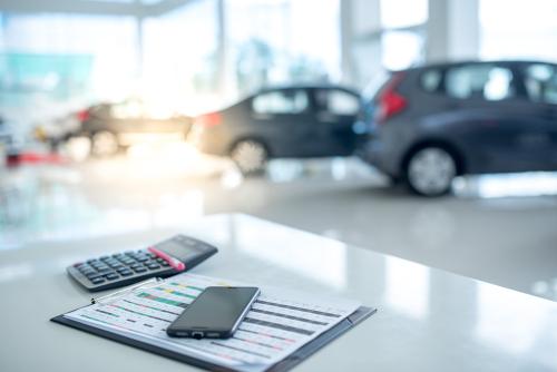 calculator sitting on desk inside car dealership
