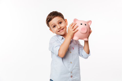child holding up a piggy bank