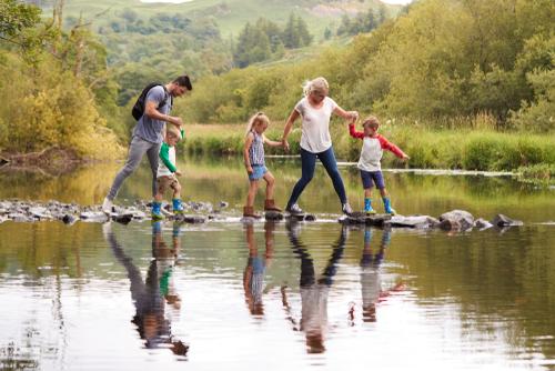 family crossing river
