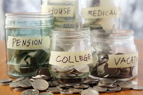 multiple jars of money with each labeled for different things to save money for
